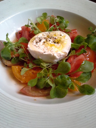 Heirloom tomato salad:  These are vegetables that you'll want to eat.  Plus, they're kinda smothered in cheese.