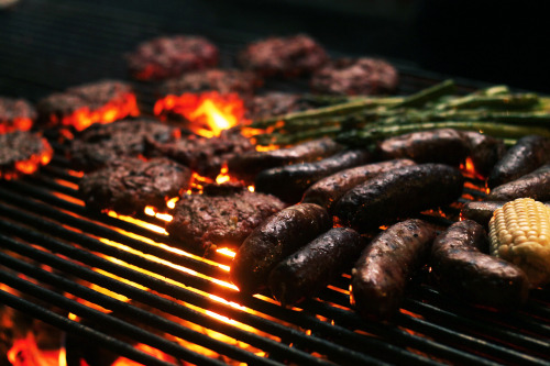 Corn, asparagus, garlic-smoked sausage, and burgers on the grill at The Twisted Tail.
